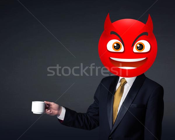 businessman wears devil smiley face Stock photo © ra2studio
