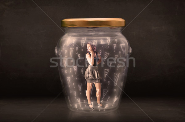 Business woman trapped in jar with exclamation marks concept Stock photo © ra2studio