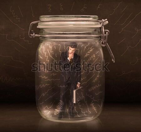 Empresário dentro jarra poderoso linhas Foto stock © ra2studio