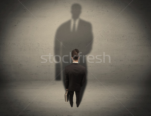 Businessman looking at big shadow concept Stock photo © ra2studio