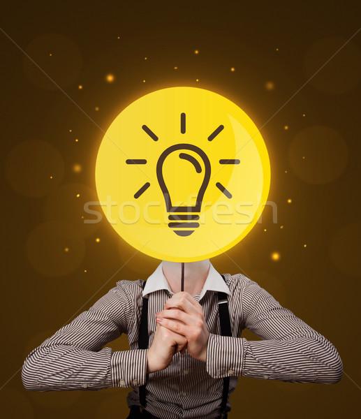 Сток-фото: бизнесмен · лампочка · знак · случайный · желтый