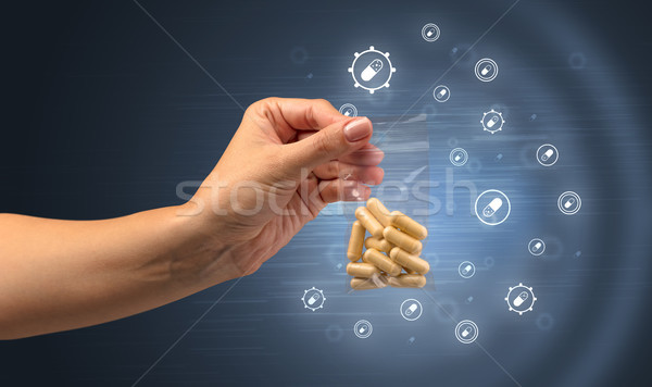 Handing over colorful painkillers  Stock photo © ra2studio