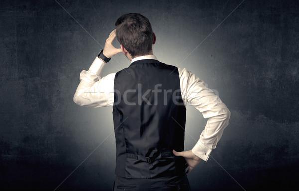 Businessman standing and thinking Stock photo © ra2studio