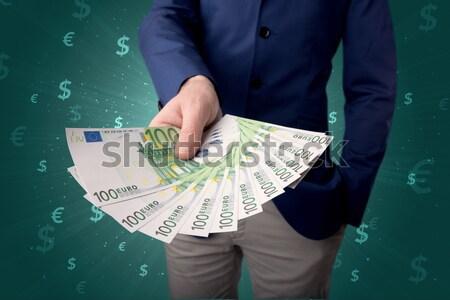 Biznesmen ceny młodych ilość Zdjęcia stock © ra2studio