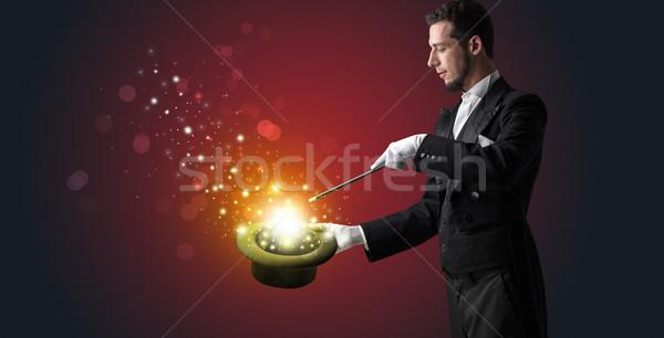 Branco mão meio luva algo misterioso Foto stock © ra2studio