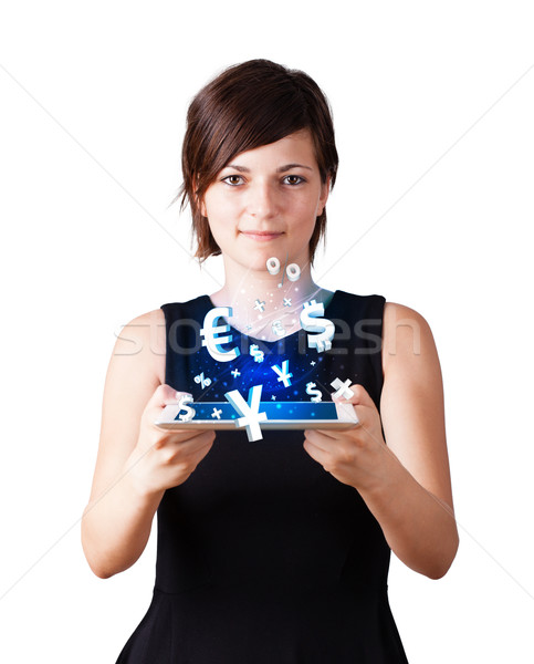 Young woman looking at modern tablet with currency icons Stock photo © ra2studio