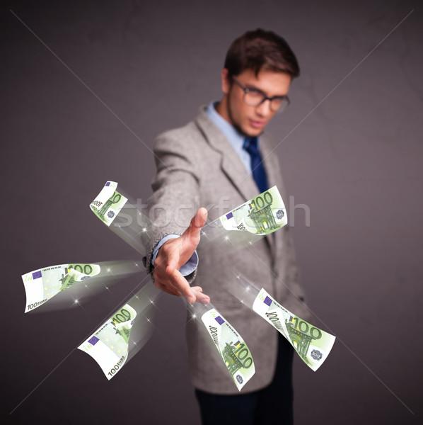 Joven pie dinero guapo fondo Foto stock © ra2studio