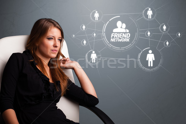 Attraente ragazza guardando moderno social network attrattivo giovane ragazza Foto d'archivio © ra2studio