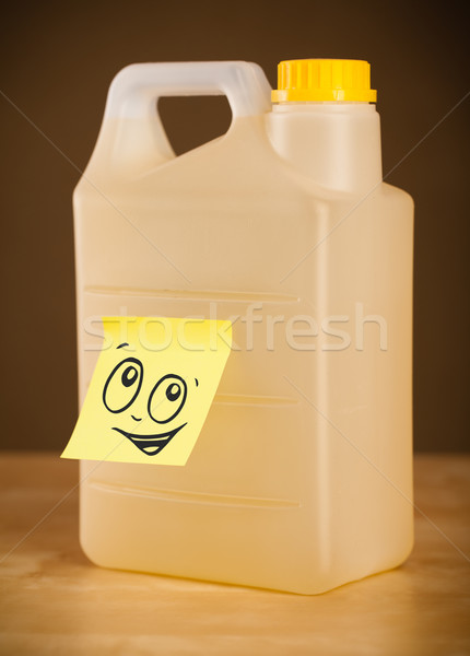 Post-it note with smiley face sticked on gallon Stock photo © ra2studio