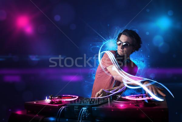 Disc jockey jugando música efectos de luz luces jóvenes Foto stock © ra2studio