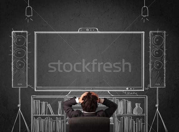 Işadamı ev sineması genç oturma adam Stok fotoğraf © ra2studio