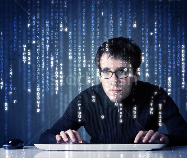 Hacker decoding information from futuristic network technology Stock photo © ra2studio