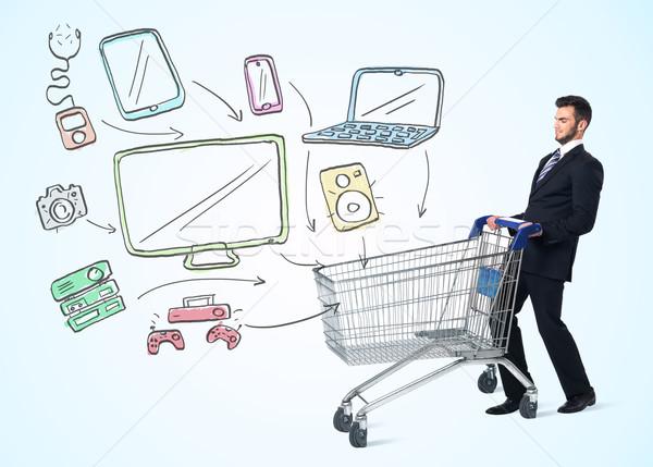 Zdjęcia stock: Biznesmen · koszyk · popychanie · mediów