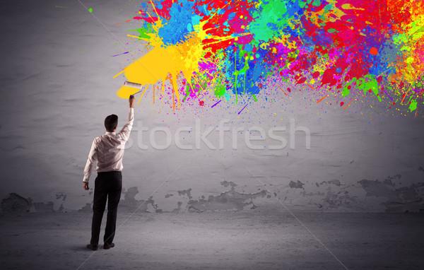 Sales person painting colorful splatter Stock photo © ra2studio