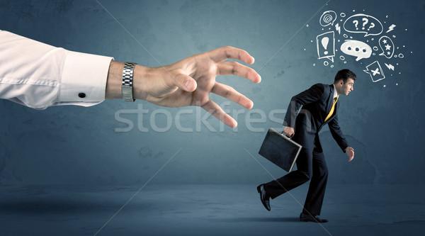 Business man running from a big hand  Stock photo © ra2studio
