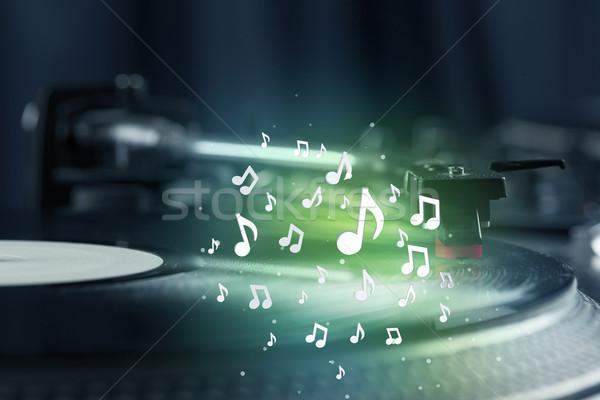 Lemezjátszó játszik zene audio jegyzetek izzó Stock fotó © ra2studio