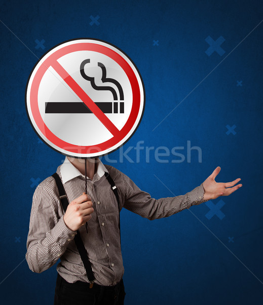 Businessman holding no smoking sign Stock photo © ra2studio