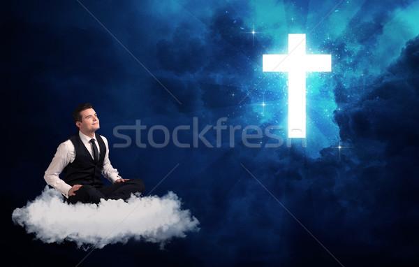 Férfi ül felhő kereszt kaukázusi üzletember Stock fotó © ra2studio