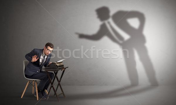 Man werken schaduw ruzie weinig groot Stockfoto © ra2studio