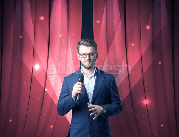 бизнесмен микрофона красный занавес Сток-фото © ra2studio