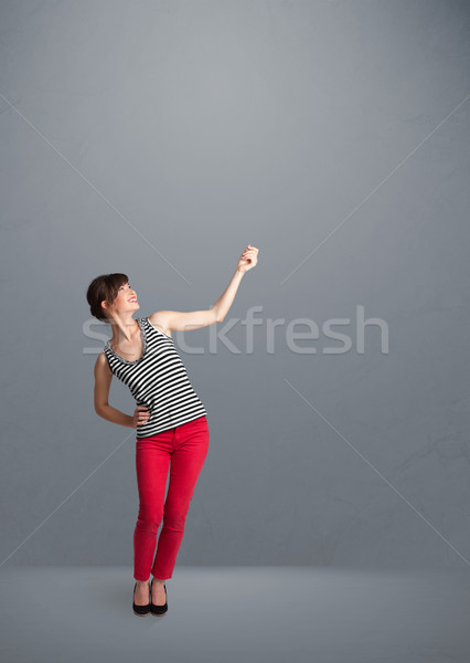 Pretty lady gesturing with copy space Stock photo © ra2studio