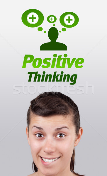 Young girl looking at positive negative signs Stock photo © ra2studio