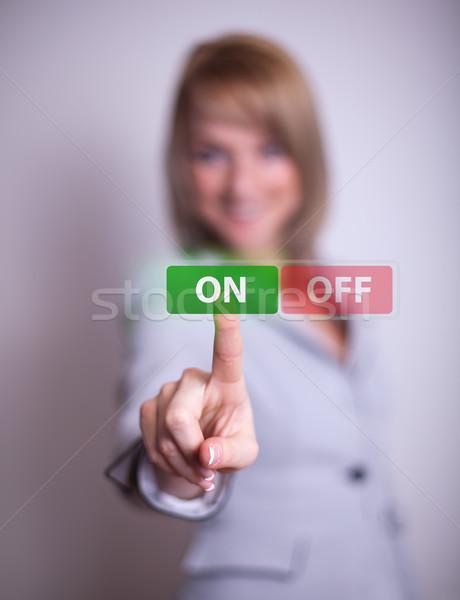 woman pressing ON / OFF button Stock photo © ra2studio
