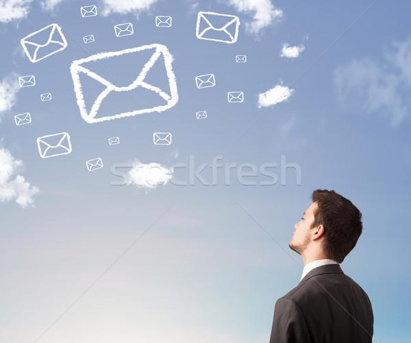 Empresario mirando mail símbolo nubes cielo azul Foto stock © ra2studio