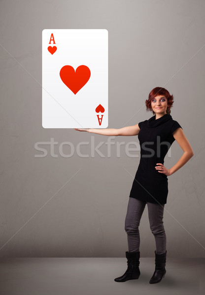Beautifu woman holding a red heart ace Stock photo © ra2studio