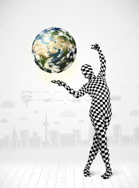 Férfi egészalakos öltöny tart Föld vicces Stock fotó © ra2studio