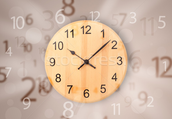 Stock photo: Modern clock with numbers comming out
