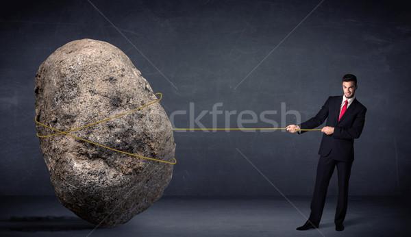ビジネスマン 巨大な 岩 ロープ 作業 ストックフォト © ra2studio