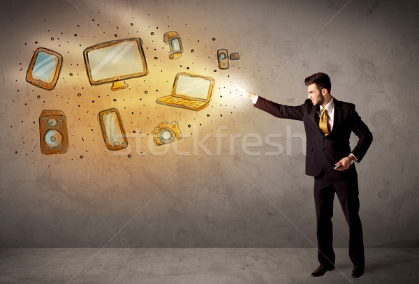 Man throwing hand drawn electronical devices  Stock photo © ra2studio