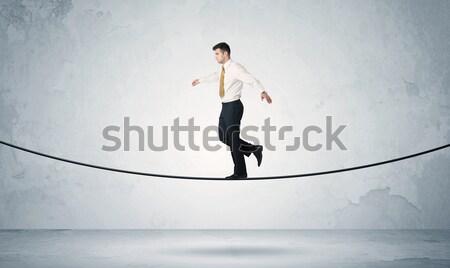 De vendas cara equilíbrio apertado corda empresário Foto stock © ra2studio
