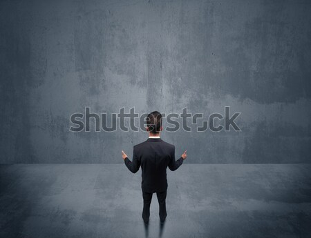 Salesman with roller standing at empty wall Stock photo © ra2studio