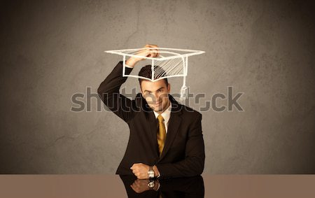 Happy college graduate drawing academic hat Stock photo © ra2studio