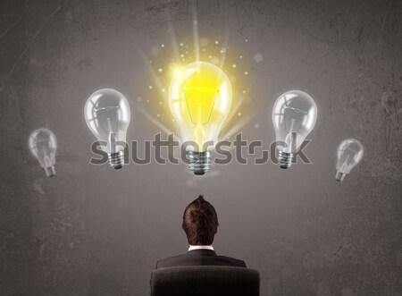 Business person having an idea light bulb concept Stock photo © ra2studio