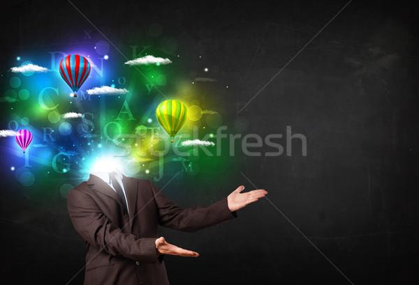Férfi öltöny álomszerű felhőkép izzó üzlet Stock fotó © ra2studio