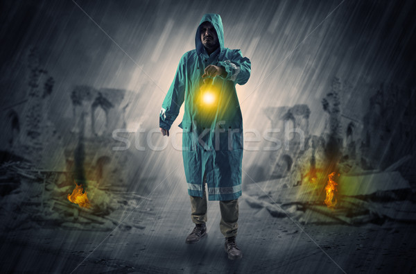 Stock photo: Man with a glowing lantern at a catastrophe scene