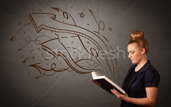 Young lady holding book with arrows Stock photo © ra2studio