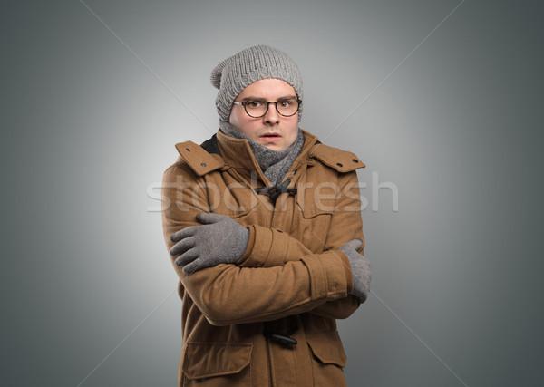 Handsome boy freezing in warm clothing Stock photo © ra2studio