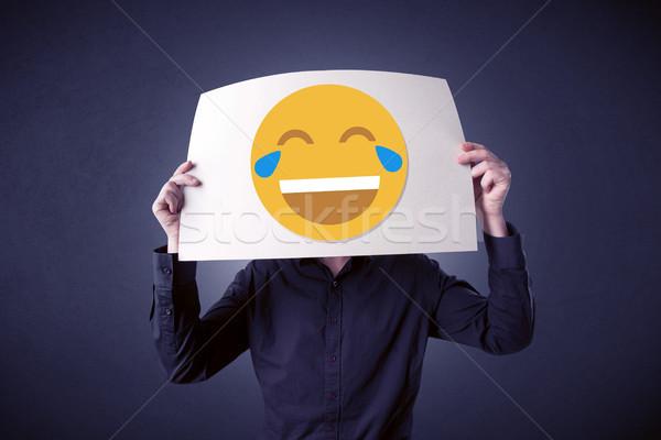 Empresario papel riendo emoticon jóvenes Foto stock © ra2studio