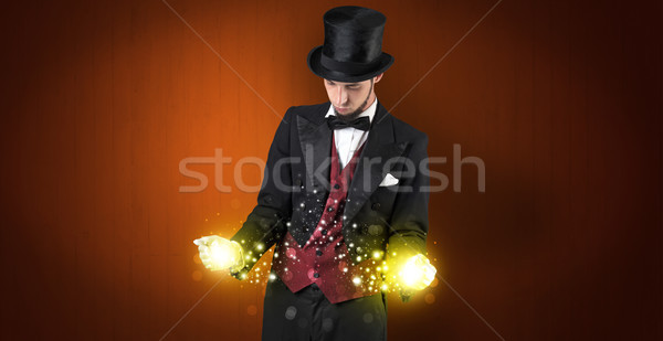 Illusionist holding superpower on his hand Stock photo © ra2studio