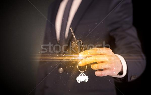 Férfi kéz kulcsok üzletember fényes sötét Stock fotó © ra2studio
