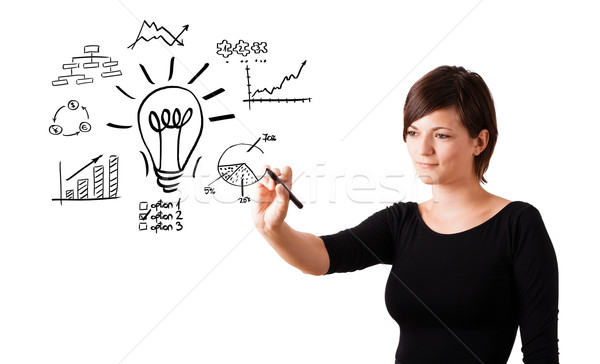 Young business woman drawing light bulb with various diagrams on whiteboard isolated on white Stock photo © ra2studio