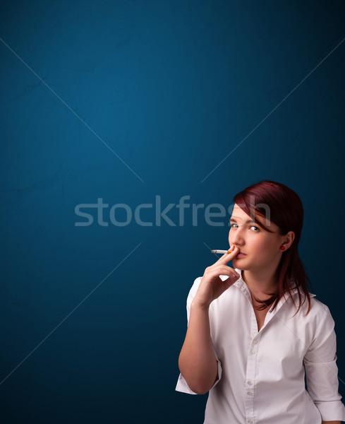 Beautiful woman smoking cigarette vith copy space Stock photo © ra2studio