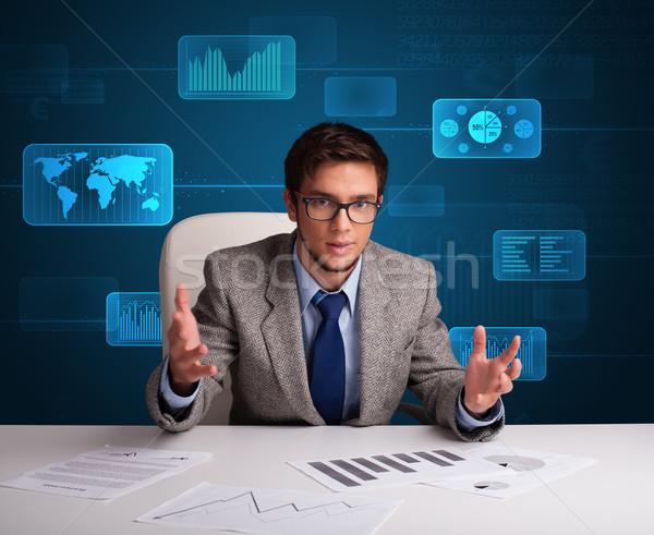 Businessman doing paperwork with digital background Stock photo © ra2studio