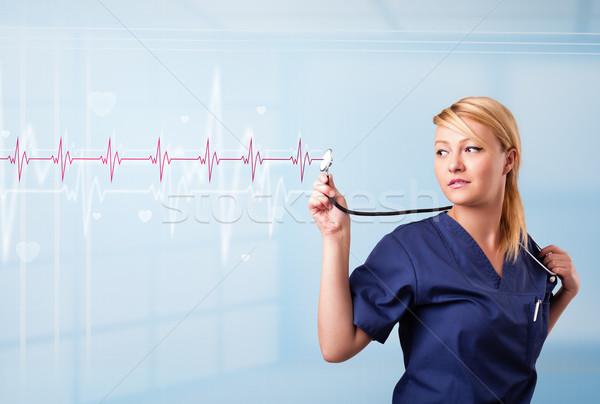 Csinos orvosi hallgat piros pulzus szív Stock fotó © ra2studio