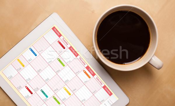 Munkahely táblagép mutat naptár csésze kávé Stock fotó © ra2studio