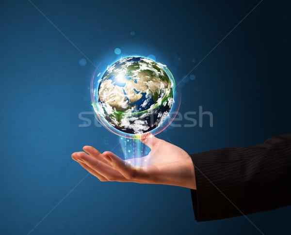 Stockfoto: Zakenman · aarde · wereldbol · jonge
